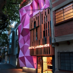 A new bubblegum pink faceted façade graces Mexico City's Hostel La Buena Vida!