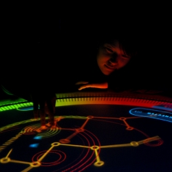 Multi - touch table installation by Los Angeles designers Nikolai Cornell, Sebastian Bettencourt, and Jonathan Jarvis