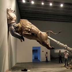 "Purveyor of oddities and sculptor of treasures Chen Wenling has made this fantastic sculpture ""What You See Might Not Be Real"" which includes a giant farting golden bull (the world economy) and the money devil (Bernie Madoff)."