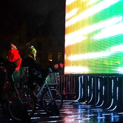 The Magic Cube by Gilbert Moity, Ben Vedren, and Pixelux Studio is a motion-graphic visualization on full scale architecture. 28 bicycles control the visualization based on performance and stamina of the rider.