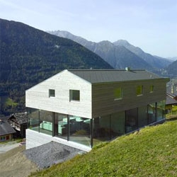 Maison Val d'Entremont by Savioz Fabrizzi Architectes offers incredible panoramic views across the Swiss countryside.