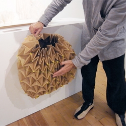 Makoto Orisaki has developed 'or-ita', a specialized blade that fits inside a rotary cutter allowing materials like cardboard to be cut and folded.