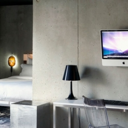 Mama Shelter's rooms include Philippe Starck stuff and 24″ iMac.
