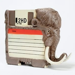 "Chicago-based illustrator Alex Solis' ""Pre-Historic"" OG - a floppy disk and mammoth combo!"