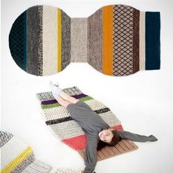 Colorful 'Mangas' (sleeves) series by Patricia Urquiola for GAN rugs showcased at Valencia Design Week. Made of 100% virgin wool.