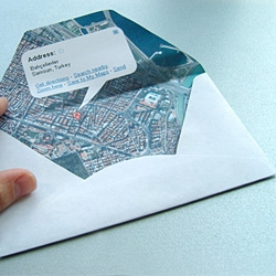 Prints your current location inside of your letter's envelope. Post it from the exact place.