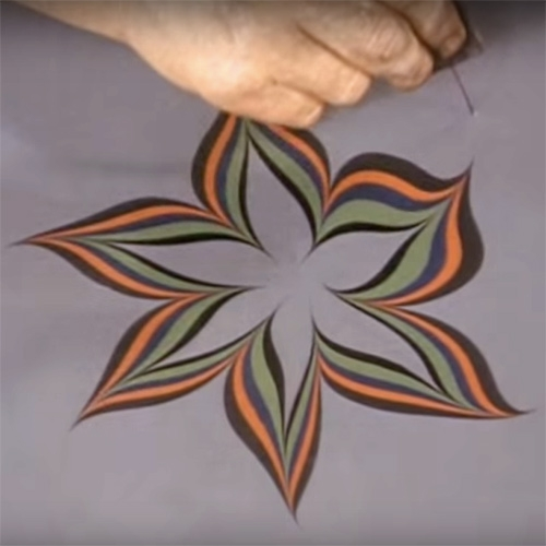 Art of the Marbler - Film made in 1970 by Bedfordshire Record Office of Cockerell marbling. It's absolutely mesmerizing... i dare you not to want to try your hand at marbling doodling after this!