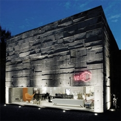 Brazilian architect Marcio Kogan designed this stylish concrete store for Volume B in Sao Paulo.