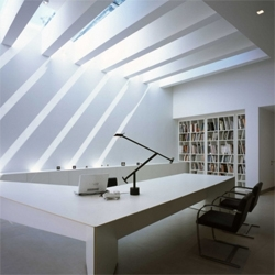 Gonzalo Mardone's arch studio features a good light work on the interiors, with a minimalistic look. I wonder where the usual mess is that you see at an architect's office.