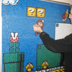 Mario mosaic made out of 17,000 Pins. True art.
