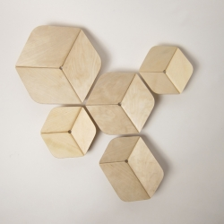 A set of hexagonal bowls in rusted steel, anodised aluminium and in veneer+cork sandwich.