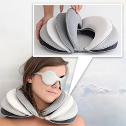 Constance Guisset's eye and neck pillows - Col de Voyage and Lunettes de Sommeil, objects inspired by the idea of Voyage and imagined for Louis Vuitton's Objects Nomades collection. Lovely neck pillow design - you can even move the flaps to stack one side.