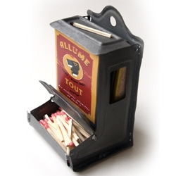Zinc match dispenser - just tape in the strike bit from a box of matches to the insides and you can strike away to your hearts content.