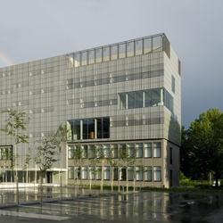 A three story slab built on top of the existing two story building and covered by a curtain of printed glass.  The Faculty of Math of the main University in Ljubljana, by Bevk Perovic.