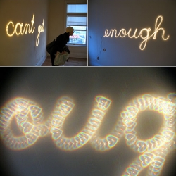 "Matt Carr's ""Can't Get Enough"" art installation made out of tube lights, that are bent into the shape of the words, and hanging lenses. ~ part of Come Up To My Room 09"