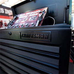 Craftsman goes Matte Black with glossy logo on this limited edition auto paint trend inspired tool cabinet ~ they also launched cabinets with built in speakers, charging stations, and pull out work spaces at CES.