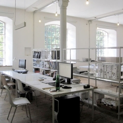 Matt Hranek visits the office of OLK Architecture in Austria, the designers behind his prefab home in upstate NY.