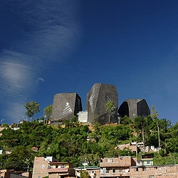 An amazing library in Colombia by Giancarlo Mazzanti. Three artificial rocks in the top of a jungleish hill with an spectacular view of Santo Domingo.