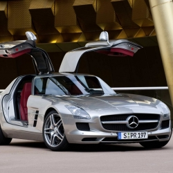 "The new 2011 Mercedes-Benz SLS AMG.  Its ""Gullwing"" design pays homage to the legendary Mercedes-Benz 300 SL.  Features a 571 horsepower engine good for 0-60 mph sprints in 3.7 seconds and a top speed of 197 mph."