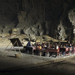 "The Dongzhong (literally meaning ""in cave"") primary school, at a Miao village in Ziyun county, southwest China's Guizhou province, is built in a huge natural cave"