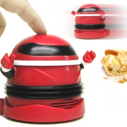 Picking up life's little messes is easy with the Robo Vacum™! This tiny desktop robot is a perfect for sucking up those kitchen crumbs and desktop debris.