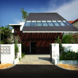 Eco house with special roof to collect solar energy. Designed by Aamer Architects for the client in Singapore