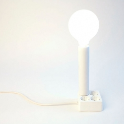 Cool lamp from Spanish Merry, Kawamura & Ganjavian. The lamp, Plug On, comes in different formats such as a column or a table top, onto which the electrical accessories can be attached. And don't miss their solar powered laptop charger...