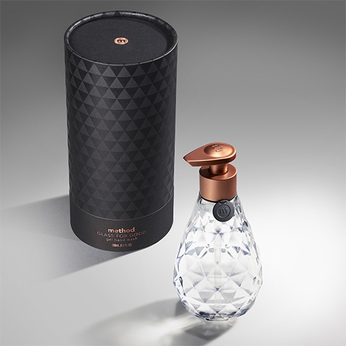 Glass For Good Hand Wash by method -  limited-edition  created by method in partnership with SFMOMA. Refillable 9 oz. bottle made from glass, topped with copper-toned hand pump, and  filled with a violet noir fragrance. Beautifully gift packaged.