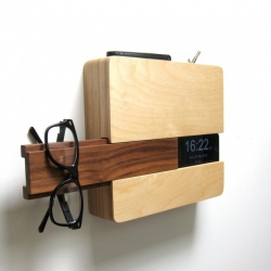 The Butler, designed to fit wallet and keys in the top sleeve, iphone on the side slot, a concealed space for charging cord, slide out walnut piece holds glasses/hat/scarf and other go-to items.