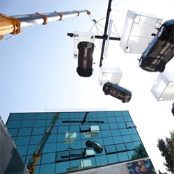 A cluster of crane suspended Mini Coopers are hanging out in Milan! Certainly one way to make you shift perspectives!