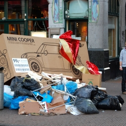 MINI launched a guerilla marketing campaign just after Christmas, strategically tossing huge cardboard boxes onto trash heaps around Amsterdam. Cartons with diagrams of the MINI, strewn with broken ribbon and torn gift wrap