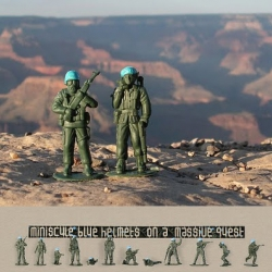 The book Miniscule Blue Helmets on a Massive Quest  by designer Pierre Derks.  People all over the world shot photos of 50,000 little plastic toy soldiers wearing hand-painted blue helmets like UN peacekeepers.