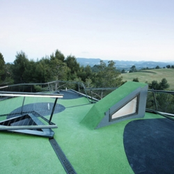 Located in Spain, this house has a complex and industrial-looking mini golf course on its roof.