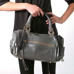 Rebecca Minkoff's latest for fall: Matinee... from model shots and product shots to a sneak peek of the launch party... we're in love with the unique details of this grey bag