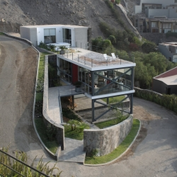 Mirador House is a minimalist home located in Lima, Peru, designed by 2.8x Architects. The project was challenging in that the surrounding topography was particularly uneven and steep.