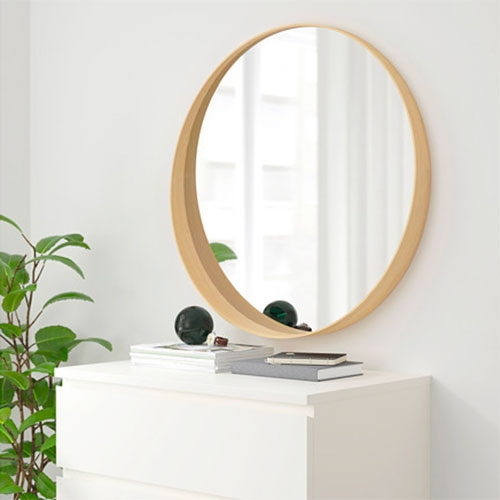 IKEA Stockholm Mirror in Ash or Walnut Veneer. Deep enough at the bottom to be a small shelf.
