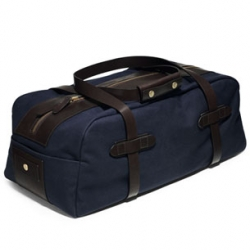 Danish brand Mismo has made this great travel canvas bag for all those guys the don't want to carry a man bag.