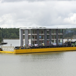 A Finnish developer builds the world's first mobile building. The apartment block is 40 feet high, 108 feet long, weighs 220 tons and can be transported in one piece by crane, car, or boat.