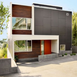 The box shape, square wooden tiles, and mixture of brown and orange color really makes the Modern Backyard House by SHED feel like a quaint and welcoming home. Check out those clean interiors!