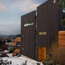 This minimalist hill house is designed by Webster Wilson. The house is built on the slope of an extinct volcano in inner city Portland. The total area space is 2600 square feet.