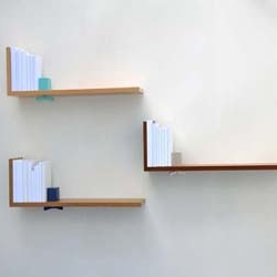 The Hold on Tight shelf by Coleen and Eric is a modern, minimalist dream. Its approach to storage includes a built-in, adjustable bookend that looks pretty hot for a shelf.