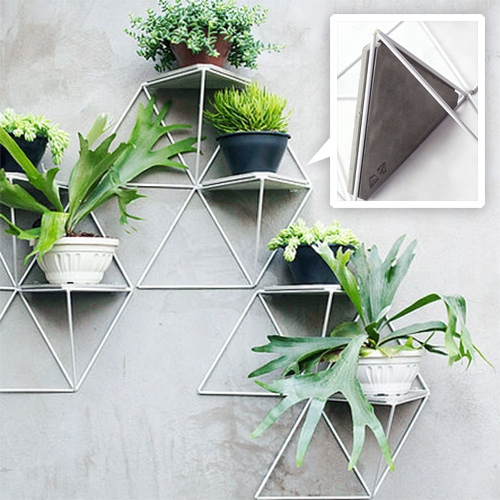 Luisa + Lilian Parrado Módulo Jardim - modular wall system of powder coated pyramids and concrete triangles. Perfect for plants!