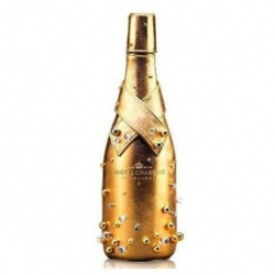 The Moet & Chandon midnight gold case is a bottle cooling case made of lambskin covered with 14 carrat gold.