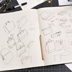 Moleskine's new collection'Writing, Travelling and Reading' includes bags, pencils, pens, computer cases, and more designed by Giulio Iacchetti. To be presented at Salone del Mobile in Milan and at the ICFF in New York.