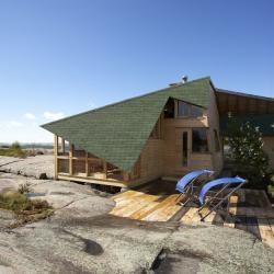Molly's Cabin by AGATHOM Architects is located on a rocky archipelago, three and a half hours north of Toronto, Canada.