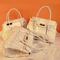 Momabomba handbags are made from recycled  first-grader homework, filled with lettering  and other exercises.