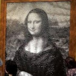 the mona lisa has been painstakingly remade out of thousands of recycled black and white commuter train tickets, thanks to the imaginative staff at takashimaya in osaka !