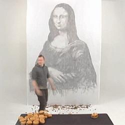 Phil Hansen paints the Mona Greasa with burger grease.