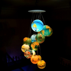 """World inside out"" is a 2meters high piece of art made by Benoit Vieubled with 15 world globes."