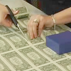 Money as giftwrap ~ see the video... you can order money sheets from the United States Bureau of Engraving